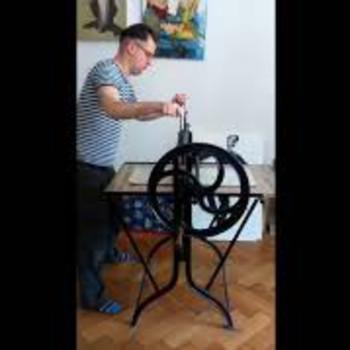 Dénes Maróti with his beloved printing press
