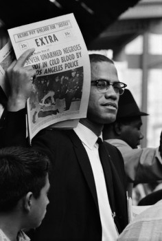 Gordon Parks, 'Malcolm X Holding Up Black Muslim Newspaper', Chicago, Illinois, 1963. © The Gordon Parks Foundation