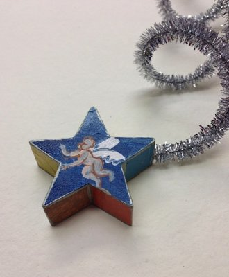 "<span class=""artist""><strong>Holly Frean</strong></span>, <span class=""title""><em>Cherub Star Tree Decoration</em>, 2013</span>"