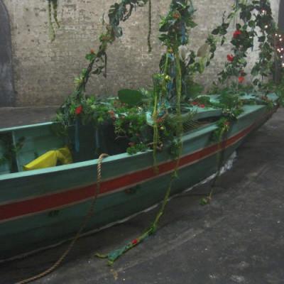 Hew Locke, Adrift, 2012, 4.7 x 5.7 x 1.2m (approx), wood, metal, artificial foliage, fairy-lights, fabric, boats