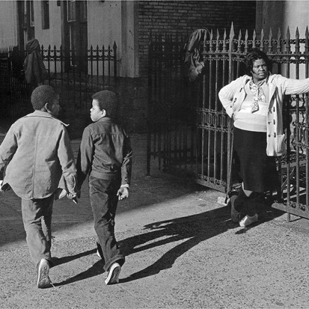 Dawoud Bey, A Woman and Two Boys Passing, 1978