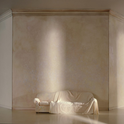 A White Draped Couch in a White Space