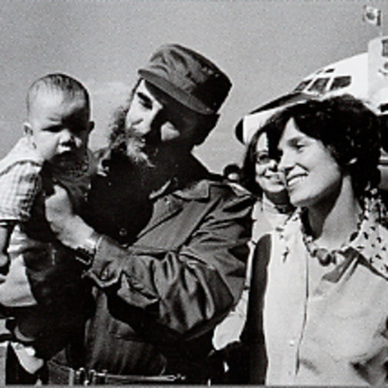 Margaret Trudeau smiles as Cuban President Fidel Castro holds her youngest son Michel after the Trudeaus arrive in Havana, Cuba