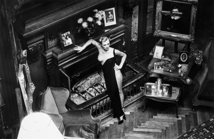 Helmut Newton, Roselyne Lights the Château , 1975