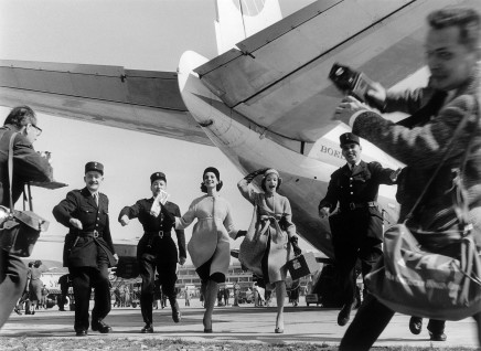 William Klein, Group Running in Front of a Pan American Boeing 707, Paris (Vogue), 1958
