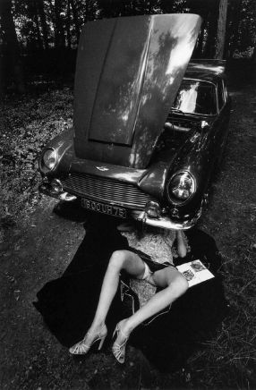 Jeanloup Sieff, Alone Under a Car with Open Hood, Paris, 1975