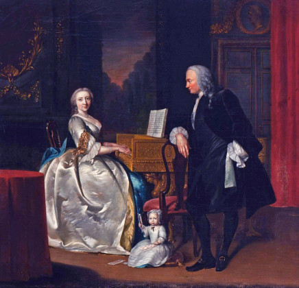 Frans van der Myn, An evening conversation piece in an opulent interior of Dr Cornelis and Mrs Henriette Hageman and their son Johan Jacob, she playing a giltwood single-manual harpsichord, he leaning on a chair and the child sitting on a cushion holding playing cards