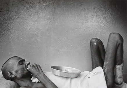 Larry Towell, Untitled [Portrait of a man lying in bed], circa 1981