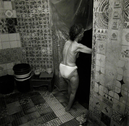 Ruth Kaplan, Hamam, Marrakesh, Morocco [older woman going through doorway], 2001
