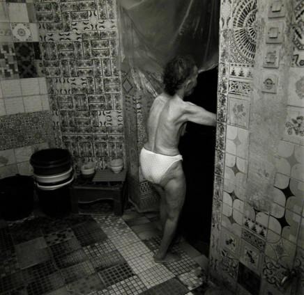 Ruth Kaplan, Hamam, Marrakesh, Morocco [older woman going through doorway], 2001