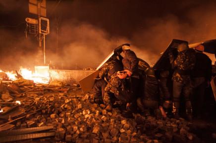 Larry Towell, Kiev, Ukraine [Protesters facing riot police. Maidan uprising. Kiev. Ukraine], February 2014