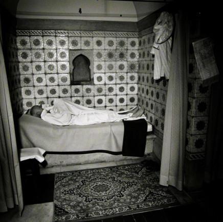 Ruth Kaplan, Hamam, Slovakia [man lying down in white robe], 1994