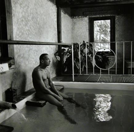 Ruth Kaplan, Mineral Bath, California [man sitting on ledge], 1991