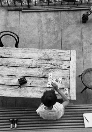 André Kertész, Saint-Gervais-les-Bains [Woman Playing Cards], 1929