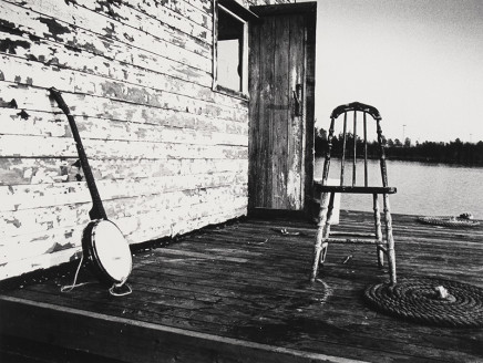 Larry Towell, Untitled [Banjo and chair on porch], circa 1974