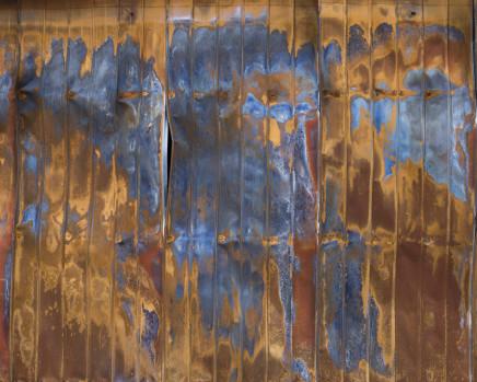 Gideon Mendel, Burnt cliplock iron sheeting wall. Sarsfield, Victoria, 2020