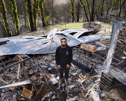Gideon Mendel, Matt Rumble at his burnt home in Yowrie, New South Wales, 2020