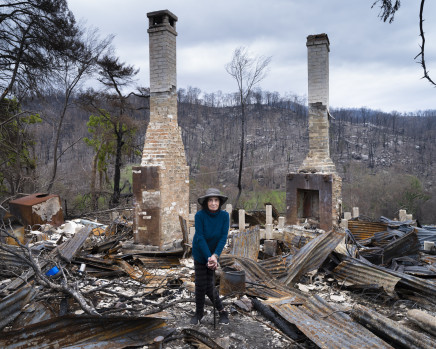 Gideon Mendel, Carol Schaefer at her burnt home in Yowrie, New South Wales, 2020