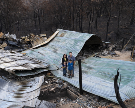 Gideon Mendel, The Montagner family at their burnt home in Upper Brogo, New South Wales, 2020