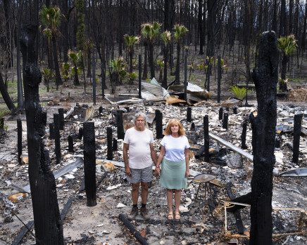 Gideon Mendel, Noel and Trish Butler at their burnt home in Nuragunyu, New South Wales, 2020