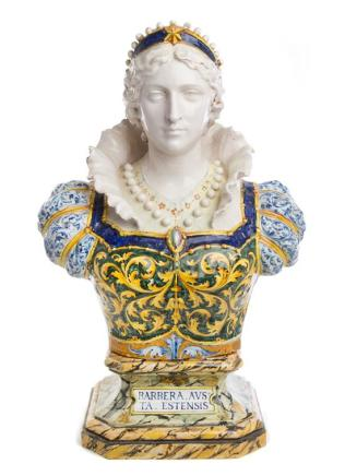 An Italian Faience Bust depicting a woman in Renaissance attire, her dress decorated throughout with foliate scrolls, raised on an octagonal plinth painted to simulate marble and inscribed Barbera Aus Ta Estensis. , 19th Century