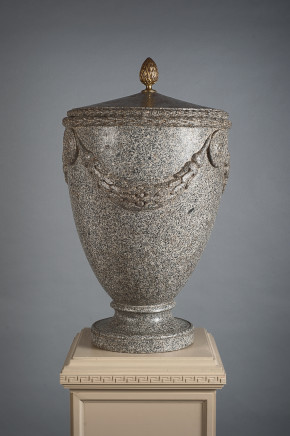 A granite vase with cover sormounted by a gilt handle and nicely sculpted with festoon motifs, Rome, 18th Century