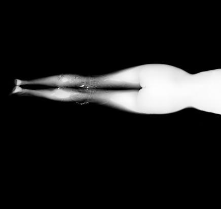 Sam Haskins, Kate swimming across river (legs only), 1964