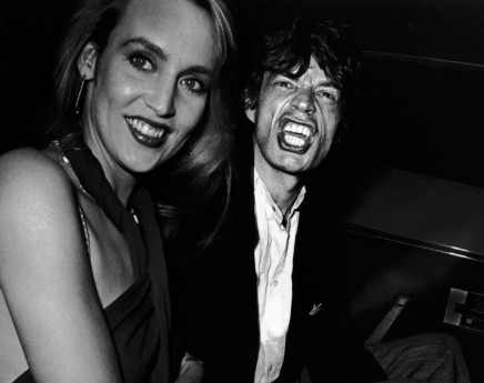 Ron Galella, Jerry Hall and Mick Jagger attend the party for Reid Rogers, Limelight, New York City, 1984