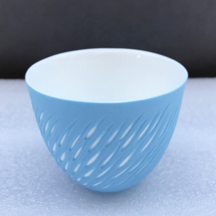 Sasha Wardell 'Shoal' Tea Bowl, 2021 blue/white layered and sliced bone china inscribed with artist's initials to base h. 6.5 cm x dia. 8 cm