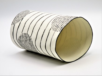 Jane Muende, Translucent white cylinder with repeated black painted 'stitch lines' and horizontal drawn lines, 2020