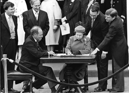 Ron Poling, The Queen signs Canada's constitutional proclamation in Ottawa on April 17, 1982 as Prime Minister Pierre Trudeau looks on