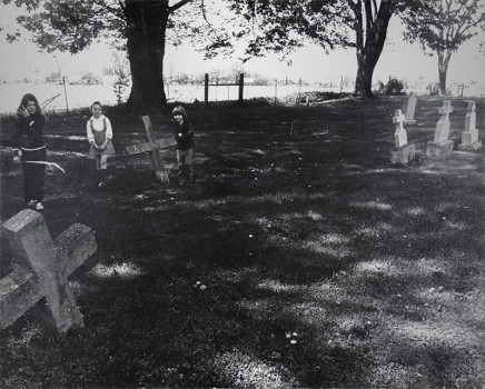 Larry Towell, Untitled [Children in a cemetery], 1974