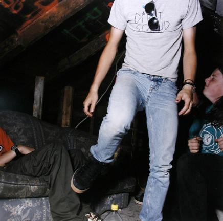 "Jaret Belliveau, Untitled [dancing in attic, ""dirt squad"" t-shirt], 2005"