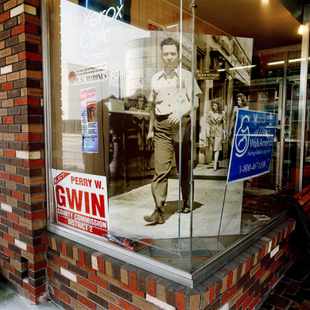 Phil Bergerson, Untitled, Gadsen, Alabama [walking man in store window], 2006
