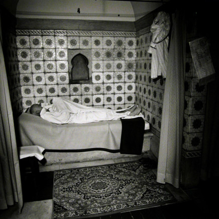 Ruth Kaplan, Hamam, Slovakia [man lying down in white robe], 1994