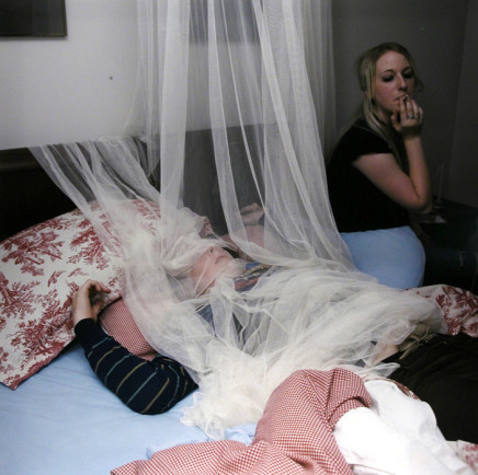 Jaret Belliveau, Untitled [laying on bed under netting], 2006