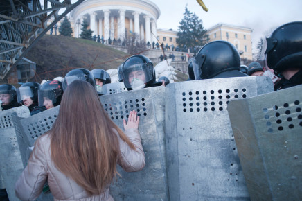 Kiev, Ukraine [Demonstrator praying for National Police. Maidan uprising. Kiev. Ukraine]