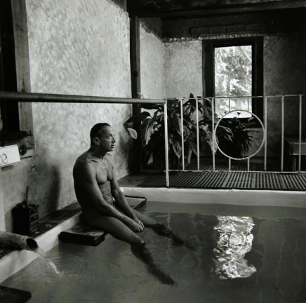 Ruth Kaplan, Mineral Bath, California [man sitting on ledge], 1991