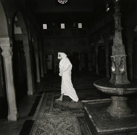 Ruth Kaplan, Hamam, Slovakia [man walking in white robe], 1994