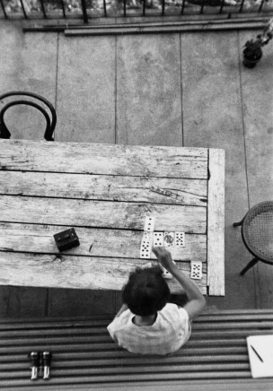 André Kertész, Saint-Gervais-les-Bains [Woman Playing Cards], 1929