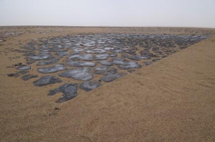 Julie Brook, Sand Line, Blue Volcanic Plates - Waw Al Namus, Al Haruj Al Aswad, Central Libya [L. 3570 cm], 2009