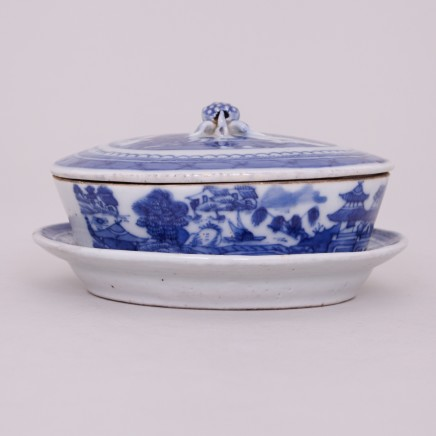 A CHINESE BLUE AND WHITE BUTTER DISH, COVER AND STAND, Daoguang (1820 - 1850)
