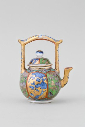 A CHINESE MINIATURE 'CLOBBERED' TEAPOT AND COVER, Kangxi 1662-1722