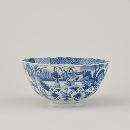 A CHINESE BLUE AND WHITE LOTUS-MOULDED BOWL, Kangxi 1662-1722