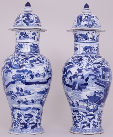 A PAIR OF HIGHLY UNUSUAL, TALL AND FINE CHINESE BLUE AND WHITE VASES AND COVERS, Kangxi (1662-1722)