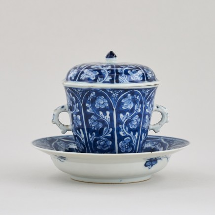 A CHINESE BLUE AND WHITE CHOCOLATE CUP, COVER, AND STAND, Kangxi (1662 – 1722)