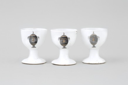 THREE UNUSUAL CHINESE ARMORIAL EGG-CUPS, Qianlong (1736-1795)