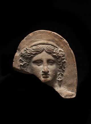 Greek terracotta antefix with female head, Taranto, c.400-375 BC