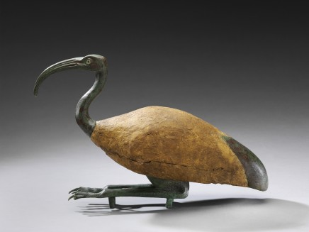 Egyptian seated ibis Late Period - Ptolemaic Period, c. 664-30 BC Wood and bronze Height 42 cm