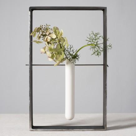 Lynne Rossington White Porcelain Test Tube Suspended within a Steel Frame Slip cast, double fired matt glaze at 1240 c H: 33cm